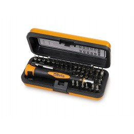 Bi-material microscrewdriver with 36 interchangeable 4-mm bits and magnetic extension